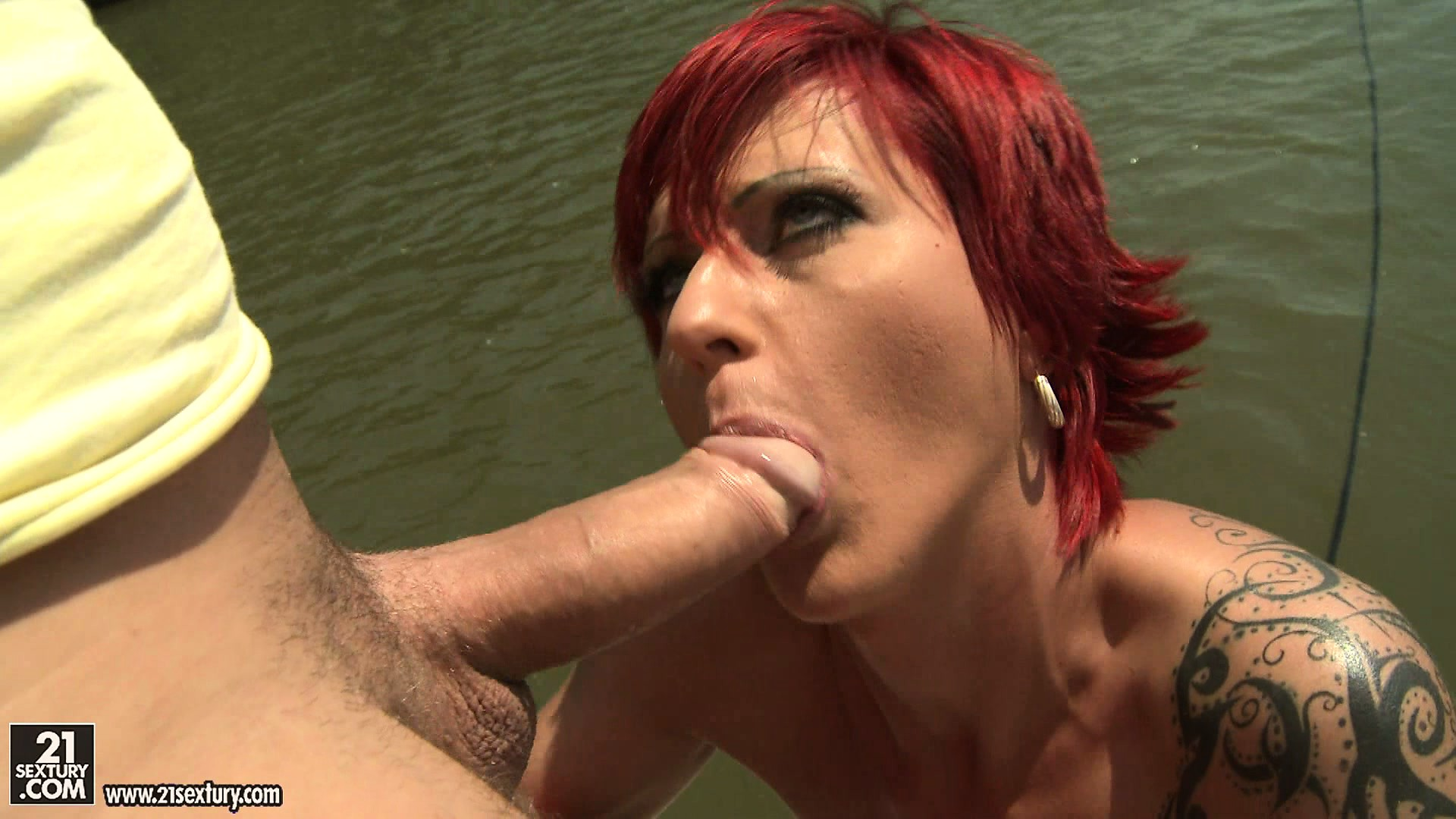 Porno Video of Tattooed Redhead Takes A Boat Ride And Goes Down On His Boner