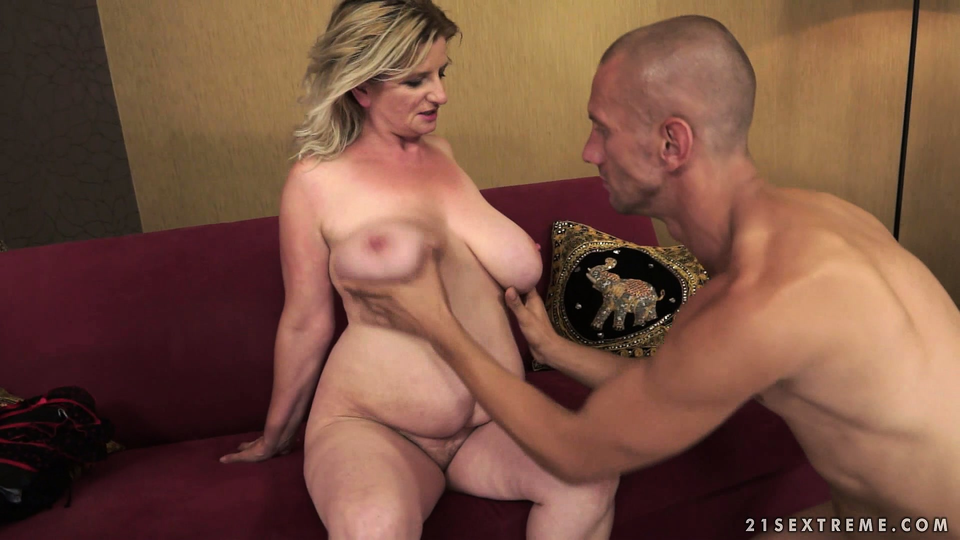 Porno Video of Fat Mature Blonde Wiggles Her Furry Wombat And He Plays With Her Juggs