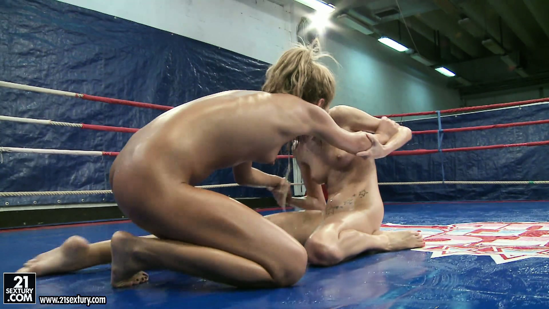 Porn Tube of Two Naked Skinny Blonde Bitches Throw Each Other Around In A Ring