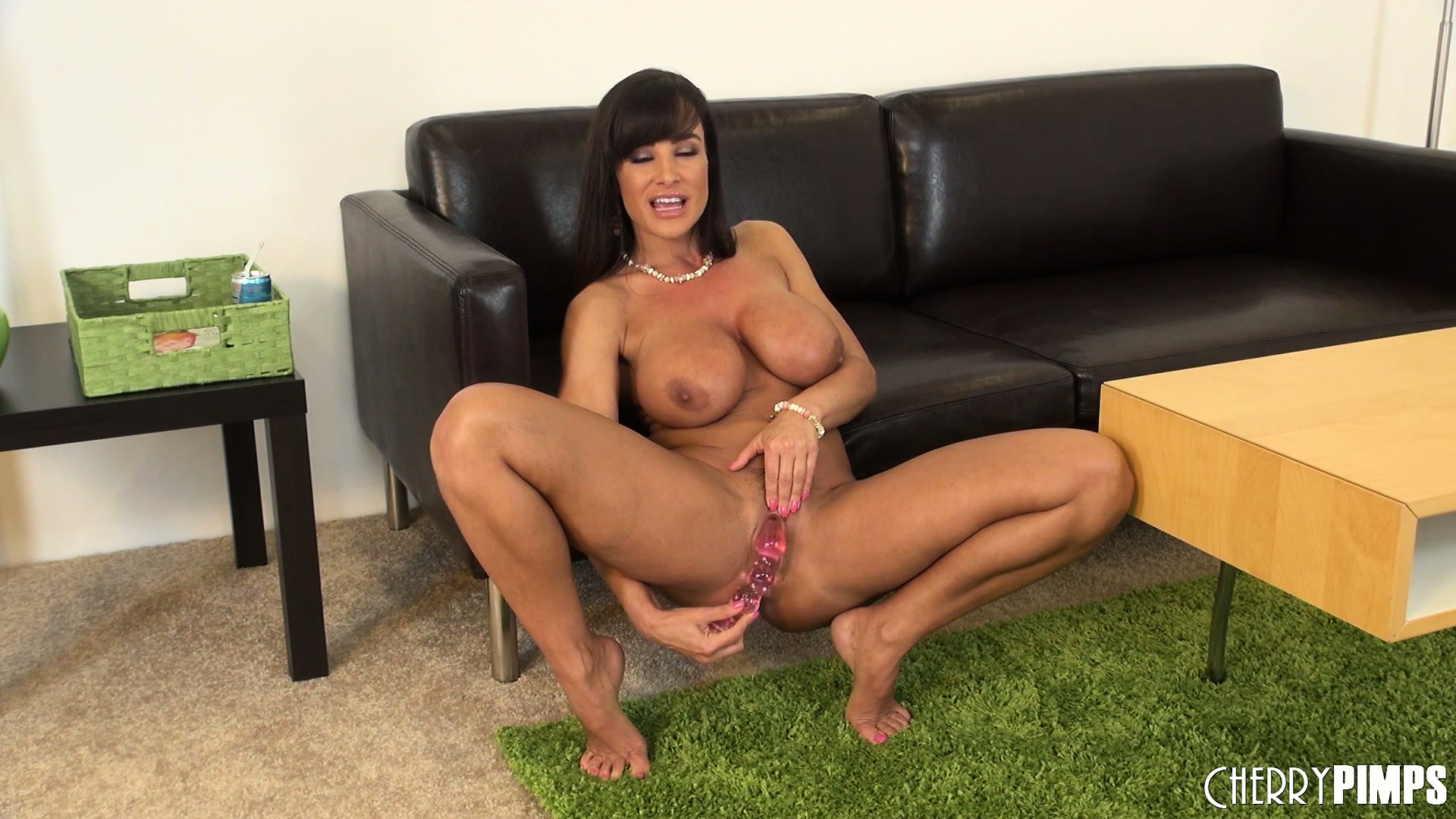 Porno Video of Lisa Ann Squats Down And Shoves Big Dildo Up Her Tight Pussy
