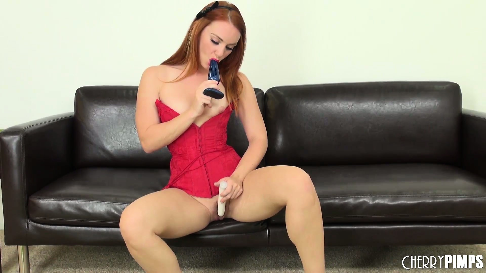 Porno Video of The Redhead Has Two Sex Toys Invading Her Holes And Loves The Pleasure They Provide