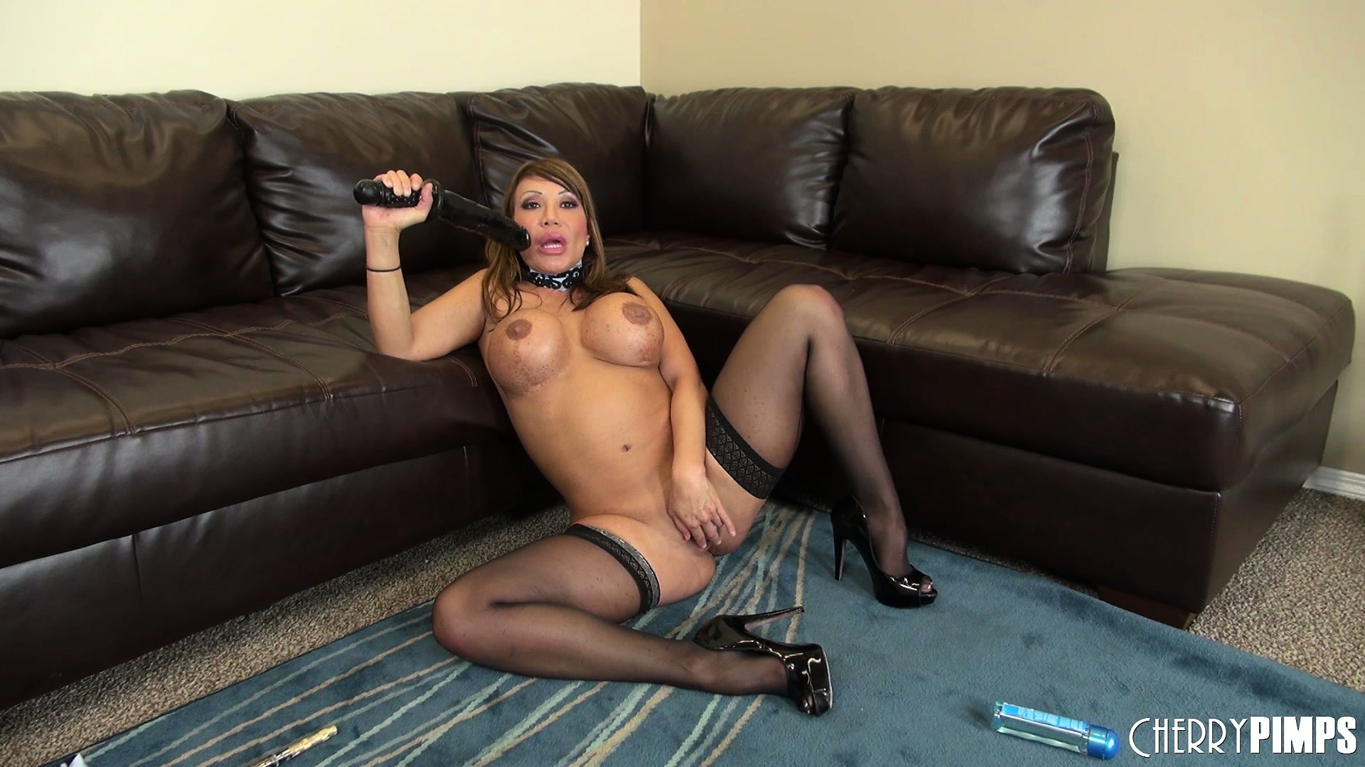 Porno Video of Busty Asian Ava Devine Toys Her Shaved Cunt On The Floor And Poses