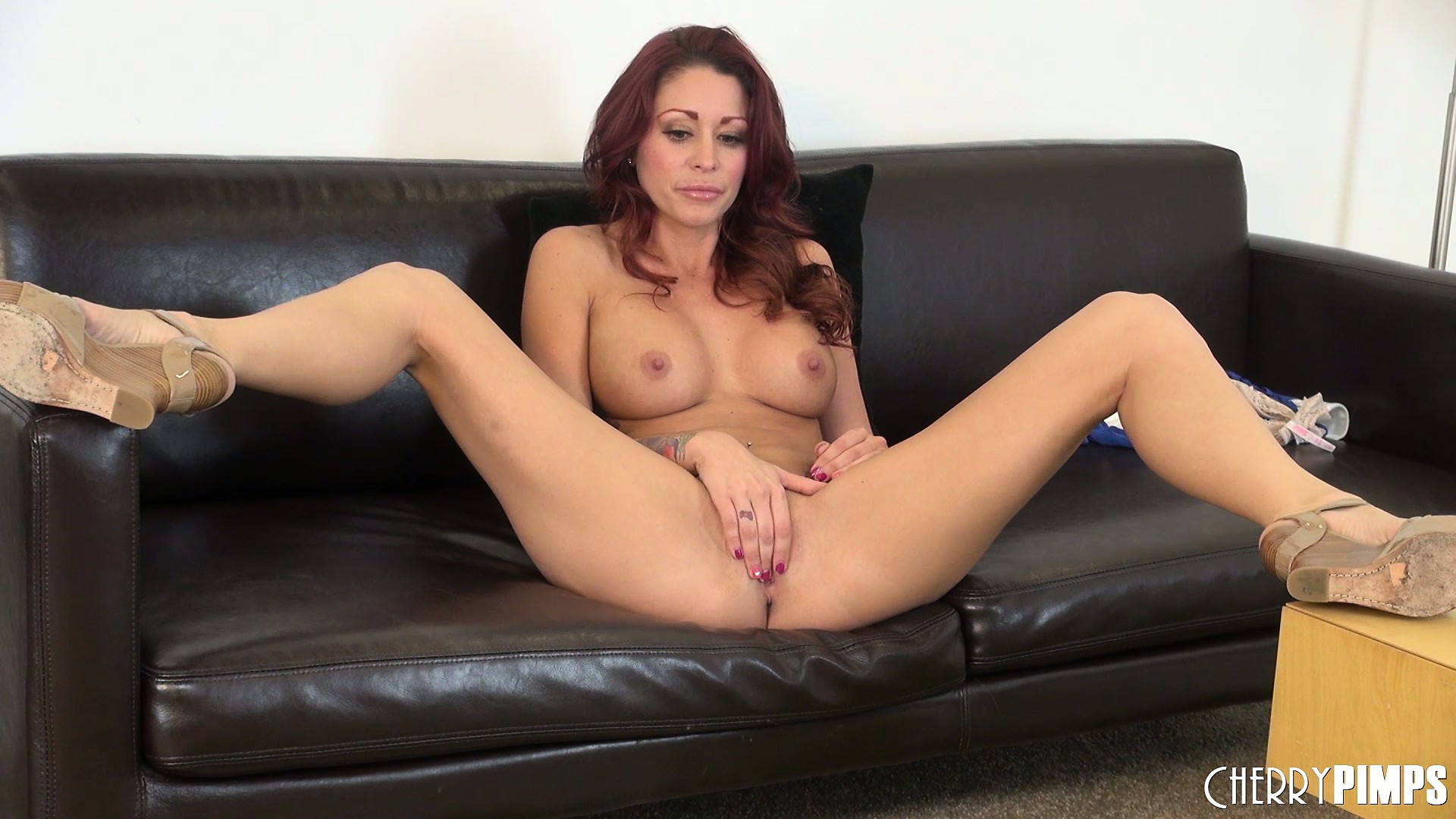Porno Video of Broad Redhead In High Heels Teases With Her Gaping Pink Snatch