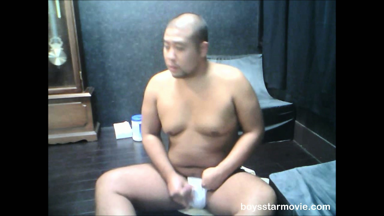 Porno Video of Chubby Oriental Dude Sits On The Floor And Plays With His Bone