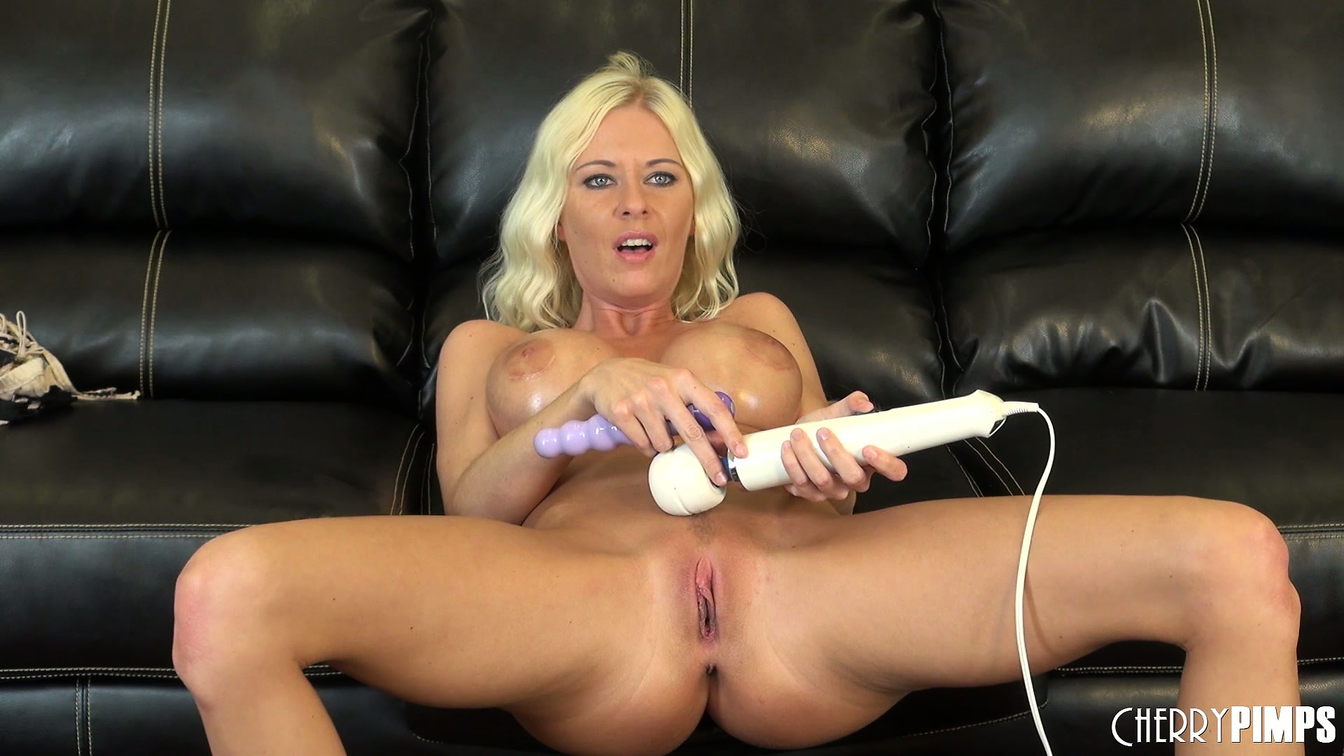 Porno Video of Riley Evans Moans As She Uses A Magic Wand On Her Sensitive Clit