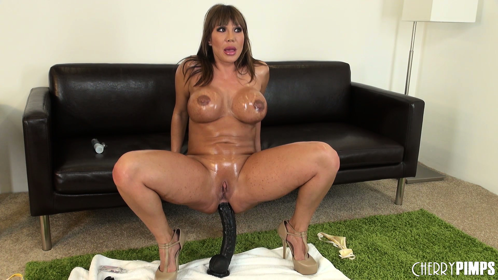 Porno Video of Busty Bitch Ava Devine Glistens With Oil During A Kinky Show