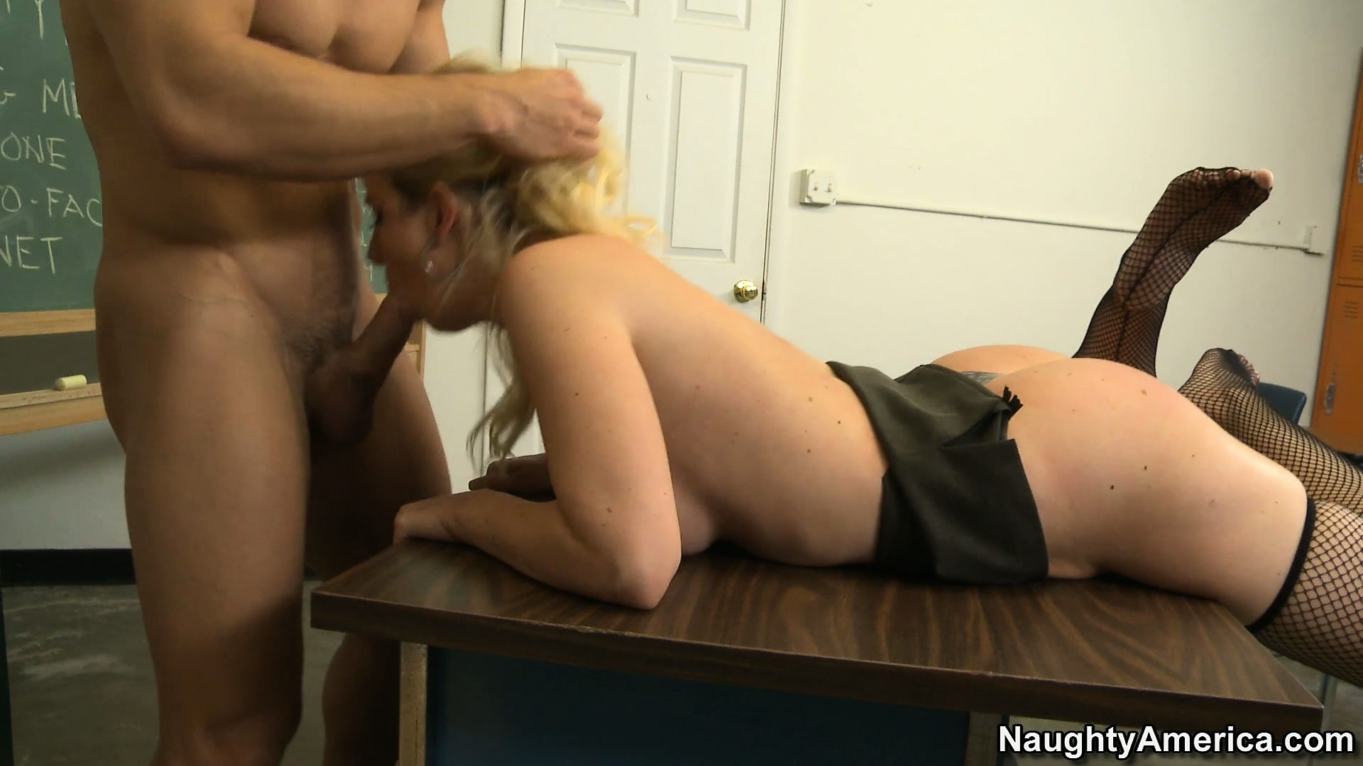 Porno Video of The Blonde Teacher Bends Over Her Table And Enjoys A Deep Pounding From Behind