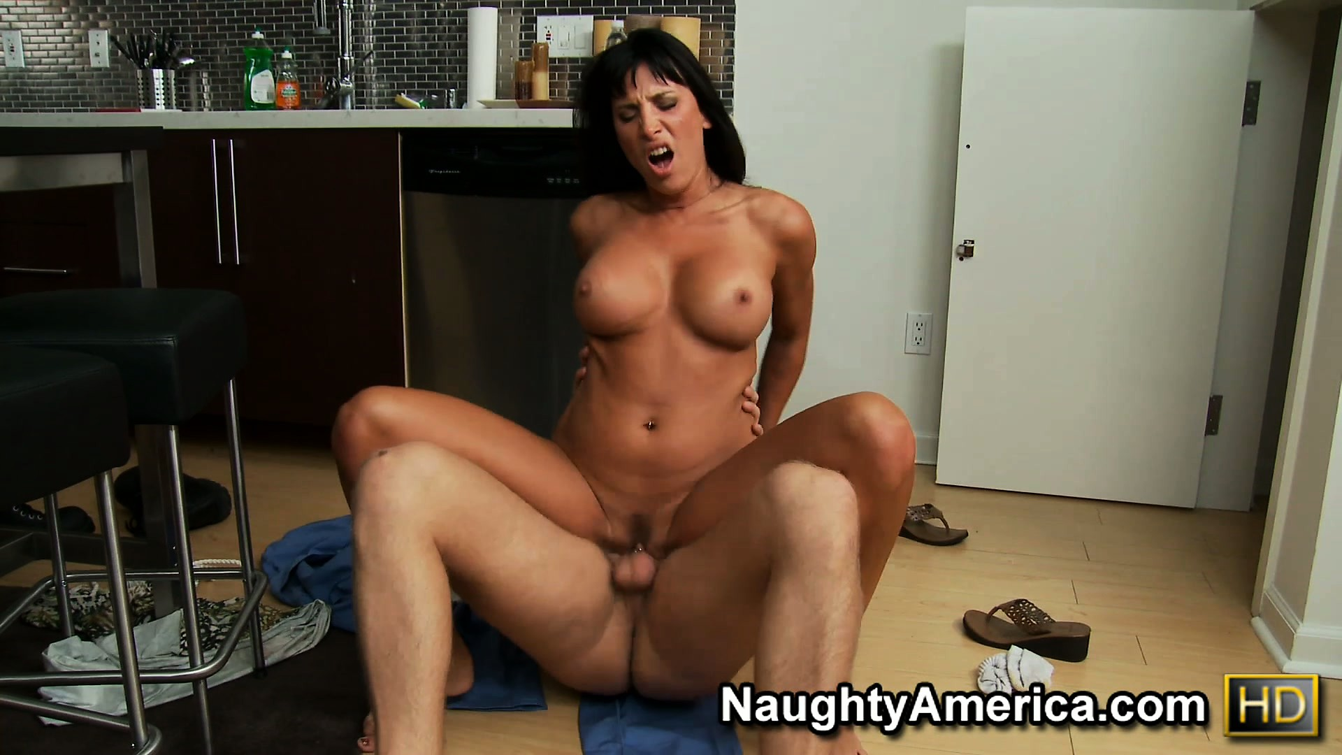Porno Video of Lezley Zen Gets Down On The Kitchen Floor And Rides A Young Cock