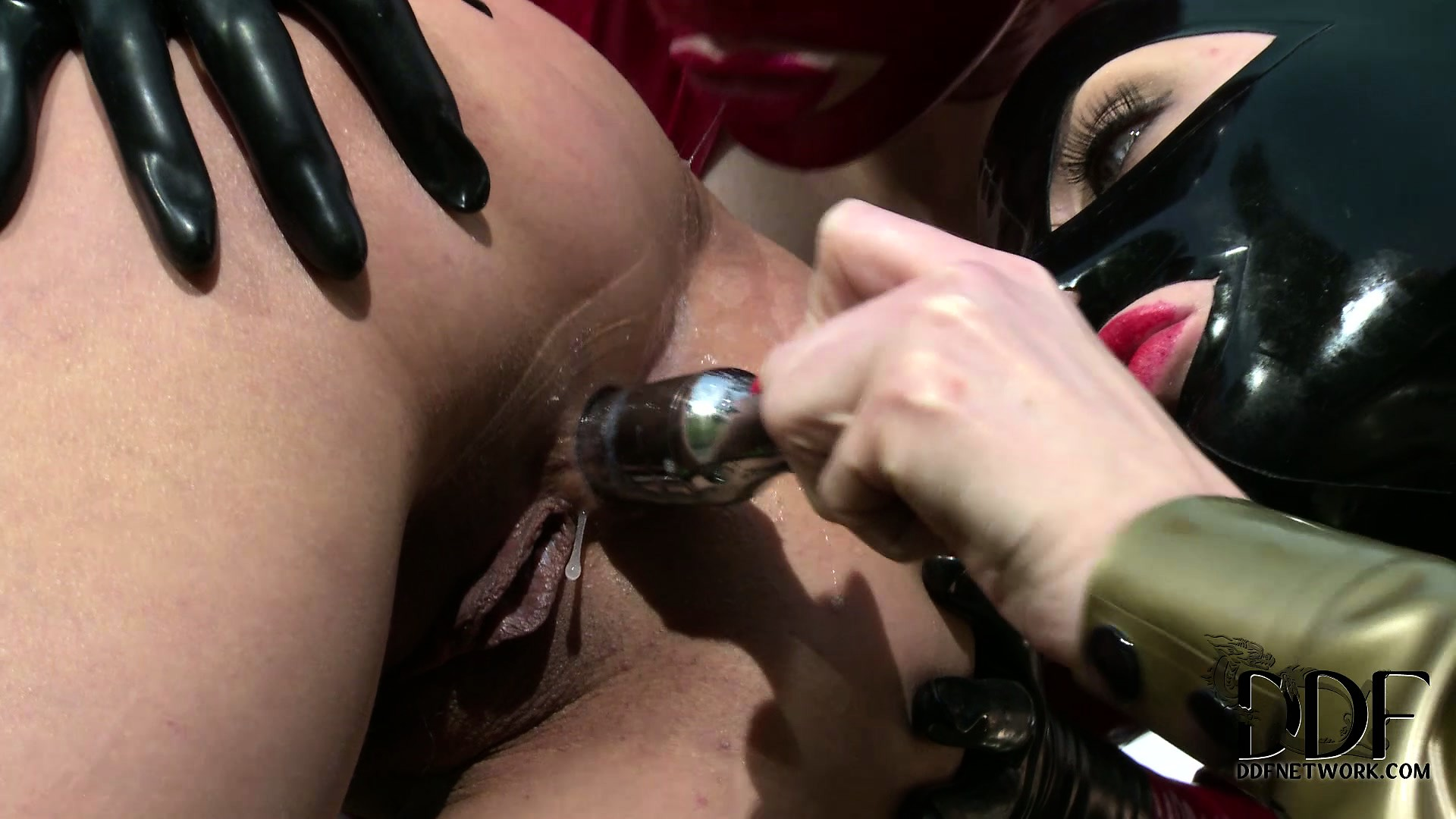 Porn Tube of Latex Clad Mistress And Slave Outside Fisting The Slave's Ass