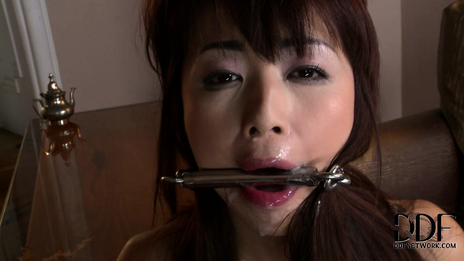Porno Video of Asian Slave Gets Her Pretty Ass Spanked Into A Bright Red Blush