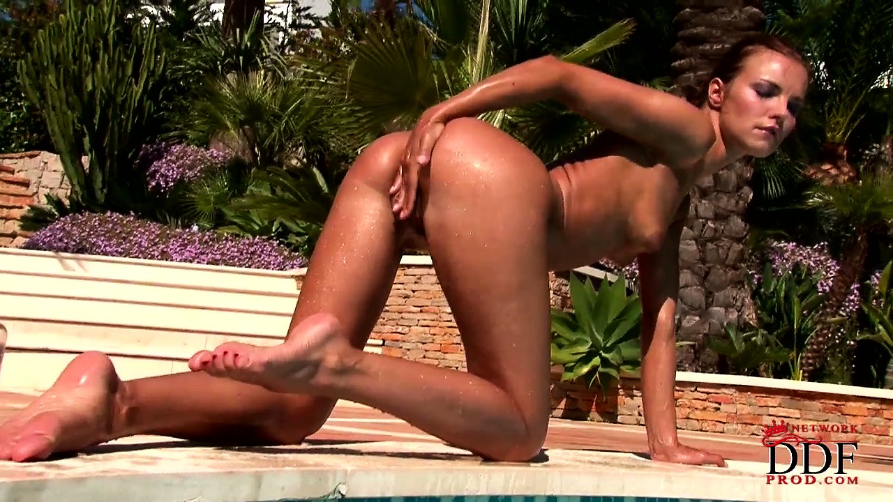Porno Video of Fine Ass Oiled Up Brunette Out By The Pool Fingering Her Snatch