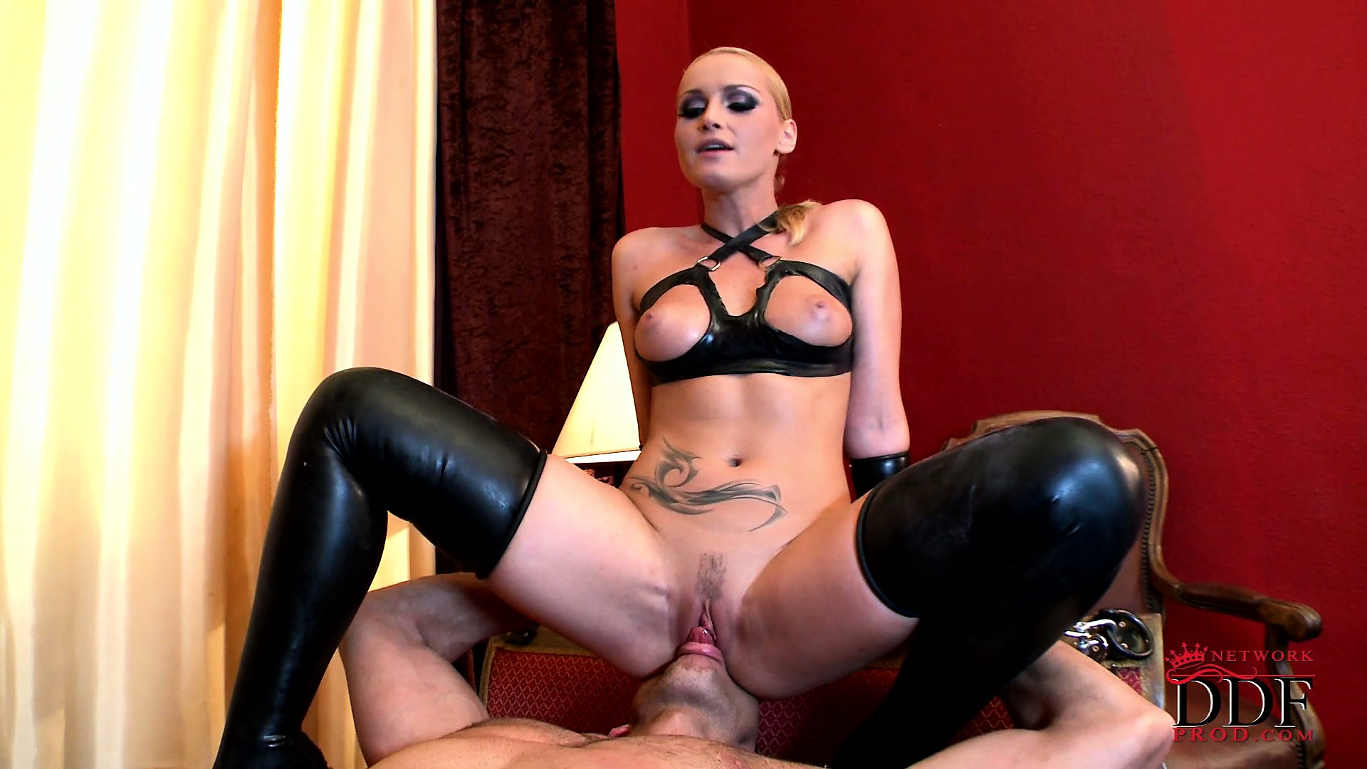 Porn Tube of Blonde Dominatrix In Latex Sits On The Face Of Her Tied Up Slave