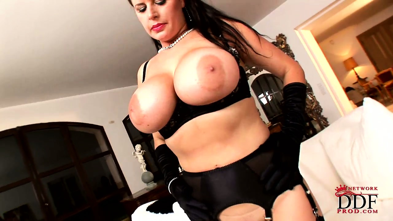 Porn Tube of Brunette Milf Poses Her Sexy Legs In Black Stockings And Bares Her Monster Melons