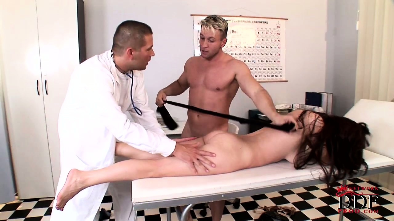 Porn Tube of Strange Threesome In The Doctor's Office With Cum On Her Feet Doing A Footjob