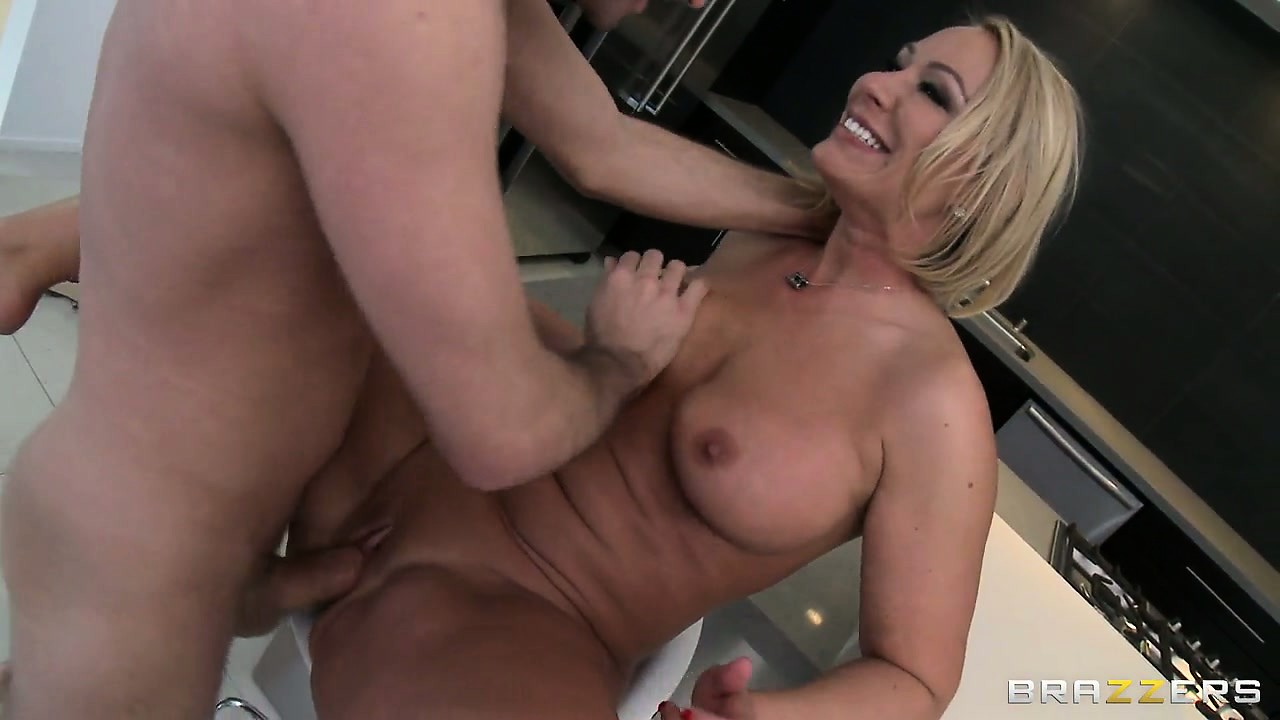 Porno Video of Hot Blonde Stepmom With A Busty Chest Proves How Fun She Can Be Getting Fucked In The Kitchen