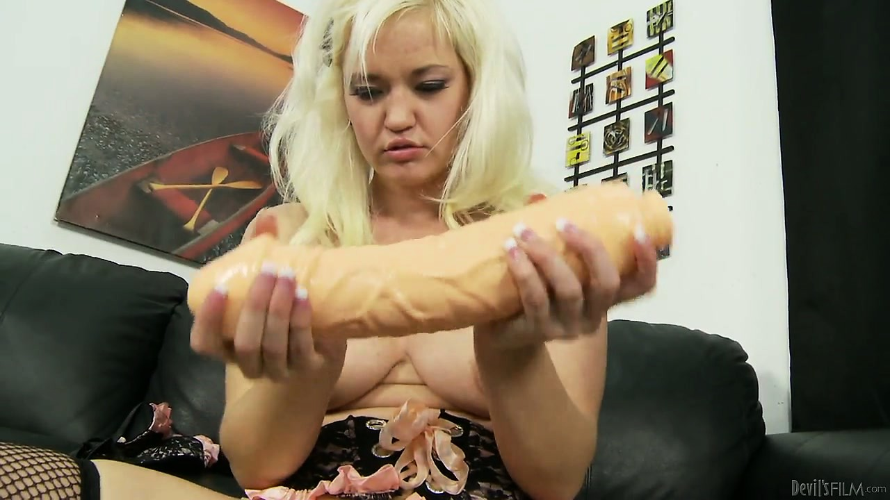 Porno Video of Blonde In Fishnets Uses Her Big Toys To Plow A Furrow In Her Pussy