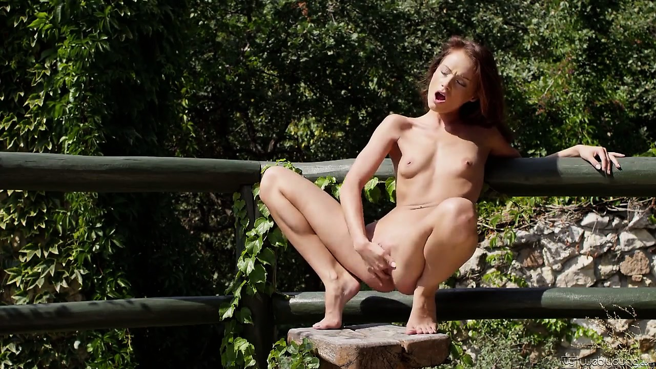 Porno Video of With The Sun Kissing Her Skin, The Wonderful Brunette Strips Her Clothes And Plays With Herself