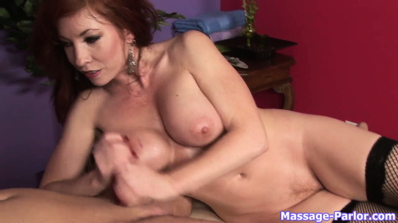 Porno Video of Busty Redheaded Cougar Lays Down Next To Her Man To Jerk Him Off