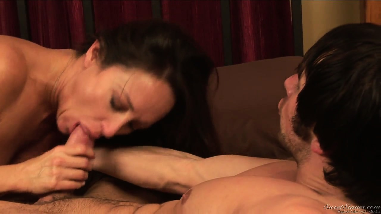 Porno Video of Sexy Cougar Chokes On Her Man's Cock Before Taking It Doggy Style