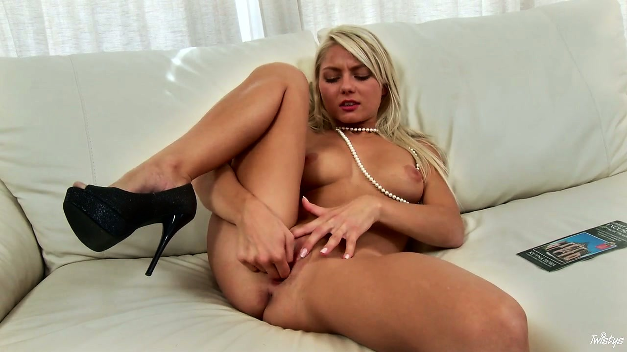 Porno Video of The Good-looking Slutty Woman In Black High-heel Shoes Spreads Her Legs Wide