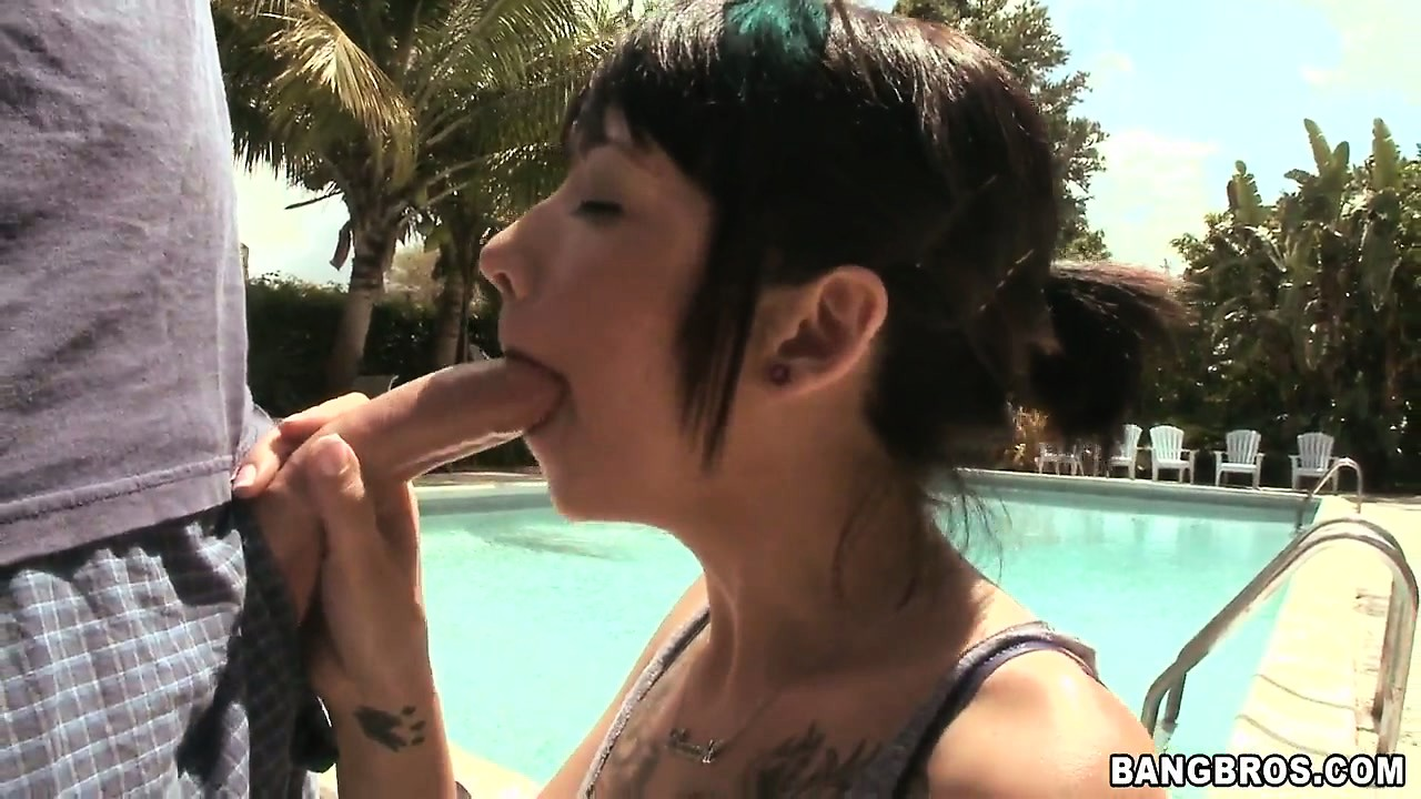 Porn Tube of Young Brunette Babe, With Nice Tattoos Is Sucking This Guy's Hard Knob By The Pool