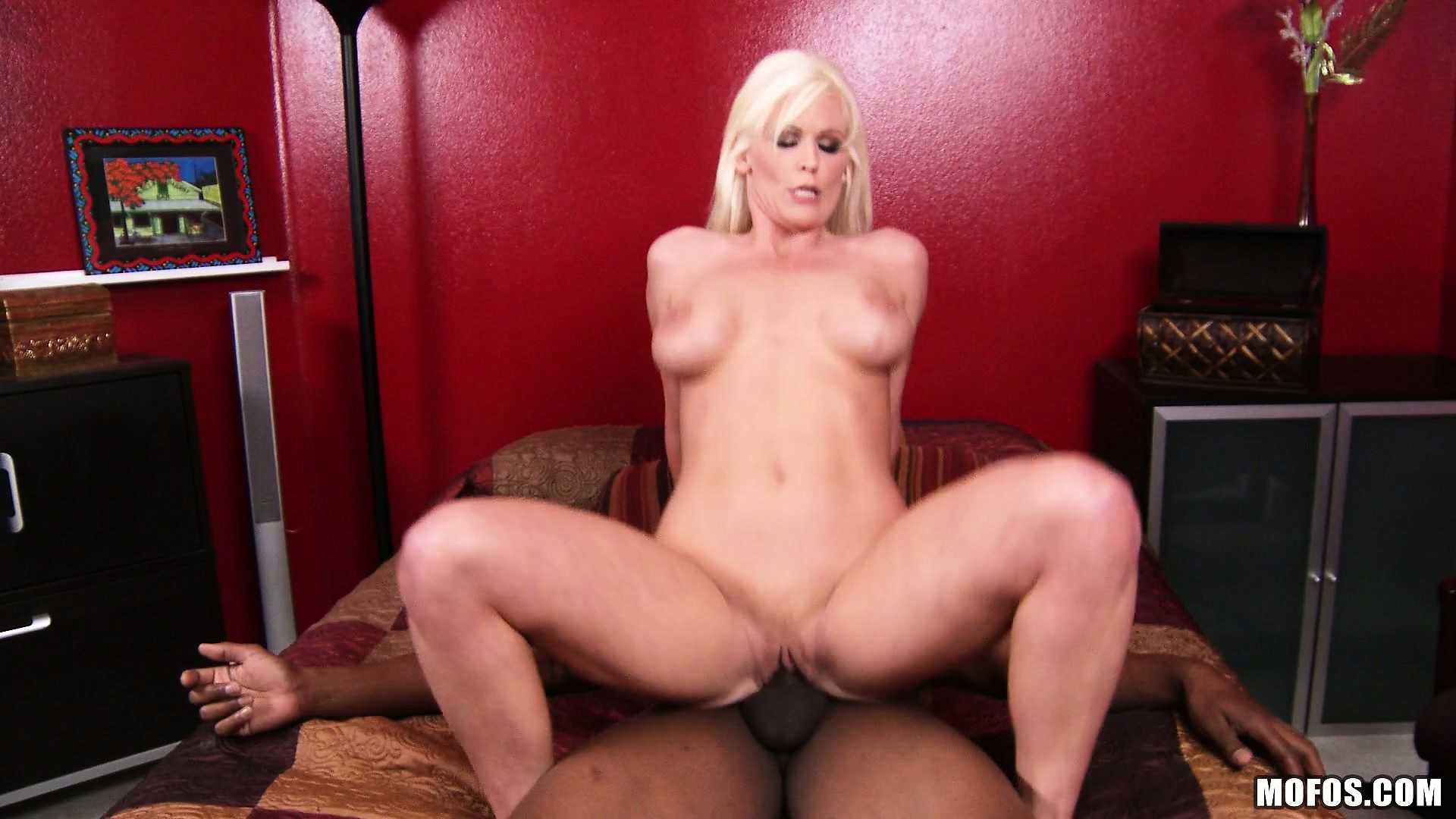 Porno Video of Juicy Blonde Bitch With Fake Tits Rides On A Big Black Schlong