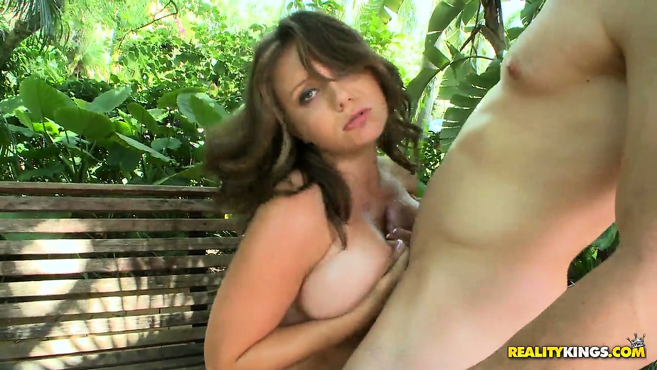 Porno Video of Young Brunette With Huge Hooters Treats His Cock To A Blowjob On The Outdoor Bench